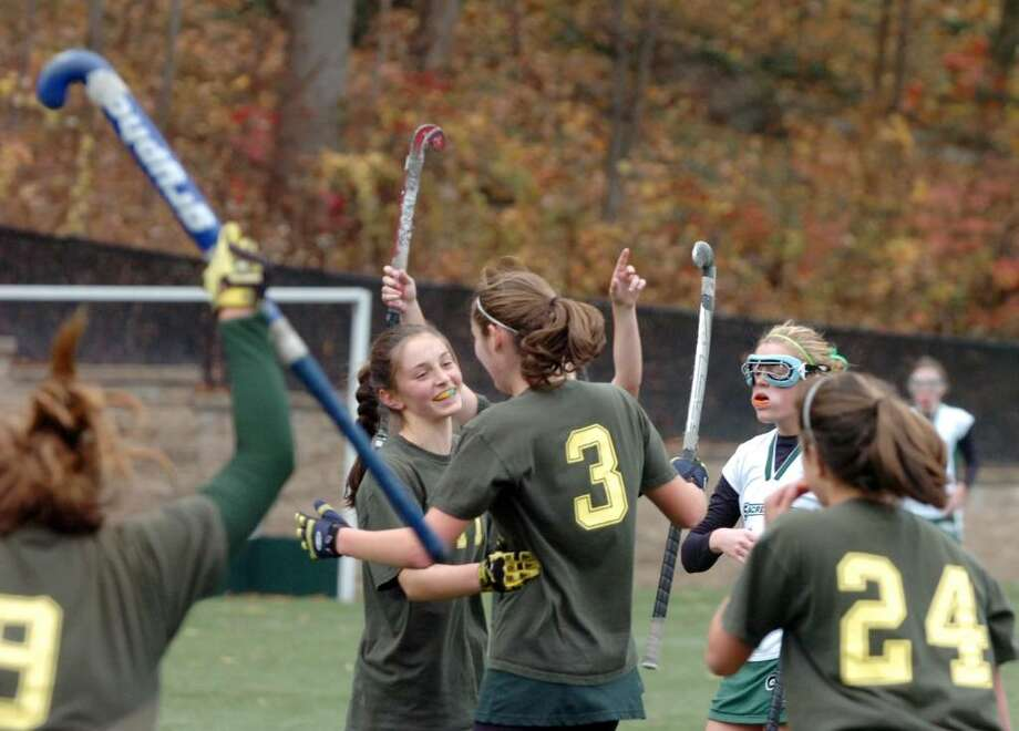 GA's Alexa Pujol (3) is congratulated by Sarah Canning after scoring as Greenwich Academy hosts the Convent of the Sacred Heart in the FAA Field Hockey Finals. GA won 4-2. Photo: Keelin Daly / Greenwich Time
