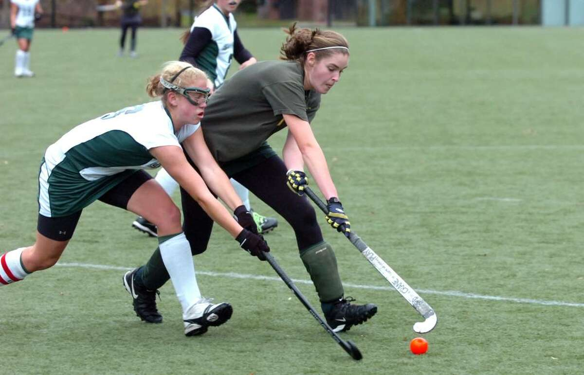 Sacred Heart's Tory Bensen battles with GA's Alexa Pujol as Greenwich Academy hosts the Convent of the Sacred Heart in the FAA Field Hockey Finals. GA won 4-2.