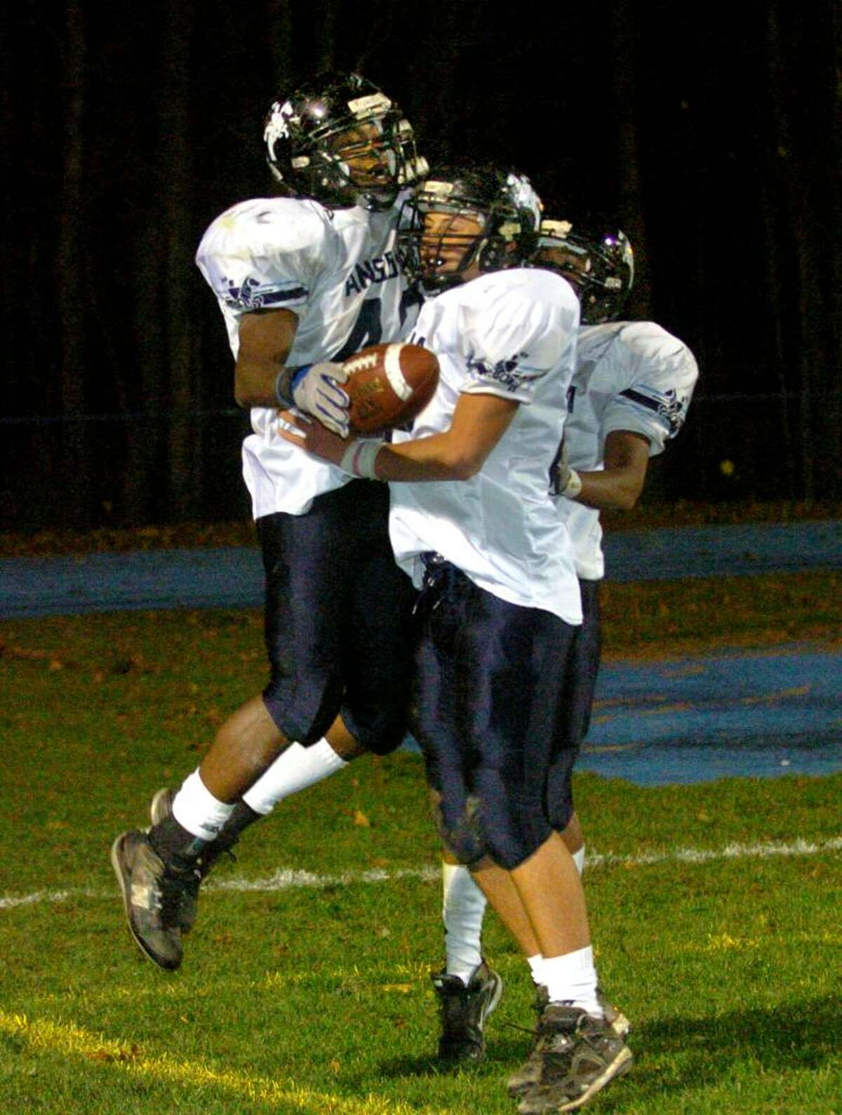 Christian Abraham/Staff photographer Ansonia's #40 Robert Kinnebrew, left, leaps into teammate #82 Jake LaRovera's arms after a touchdown, during football action against Seymour in Seymour, Conn. on Thursday Nov. 12, 2009. Ansonia defeated Seymour 51-21.