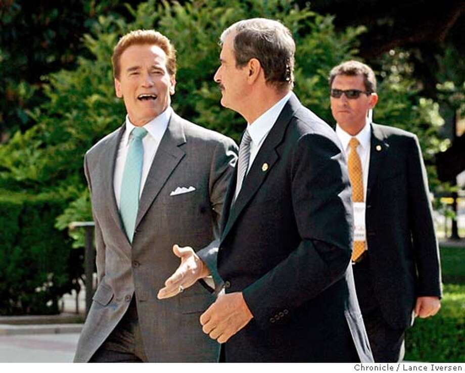 FOX_188.JPG  California Gov Arnold Schwarzenegger walks up the steps of the Capital with Mexican President Vicente Fox shortly after his arrival for a two-day visit to the State Capital Thursday. 5/25/06 in SACRAMENTO.  LANCE IVERSEN/SAN FRANCISCO CHRONICLE MANDATORY CREDIT PHOTOG AND SAN FRANCISCO CHRONICLE/ MAGS OUT Photo: LANCE IVERSEN
