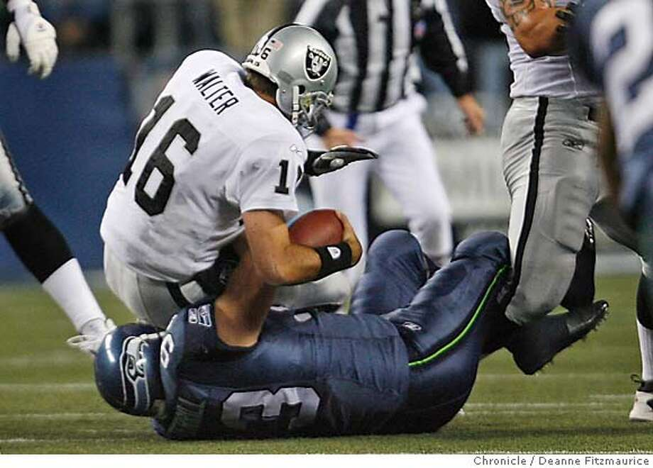 Andrew Walters gets sacked, one of many sacks of the night. The Oakland Raiders play the Seattle Seahawks at Qwest Field (cq) on Monday Night Football. Event in Seattle on 11/6/06. (Deanne Fitzmaurice/ The Chronicle) Photo: Deanne Fitzmaurice