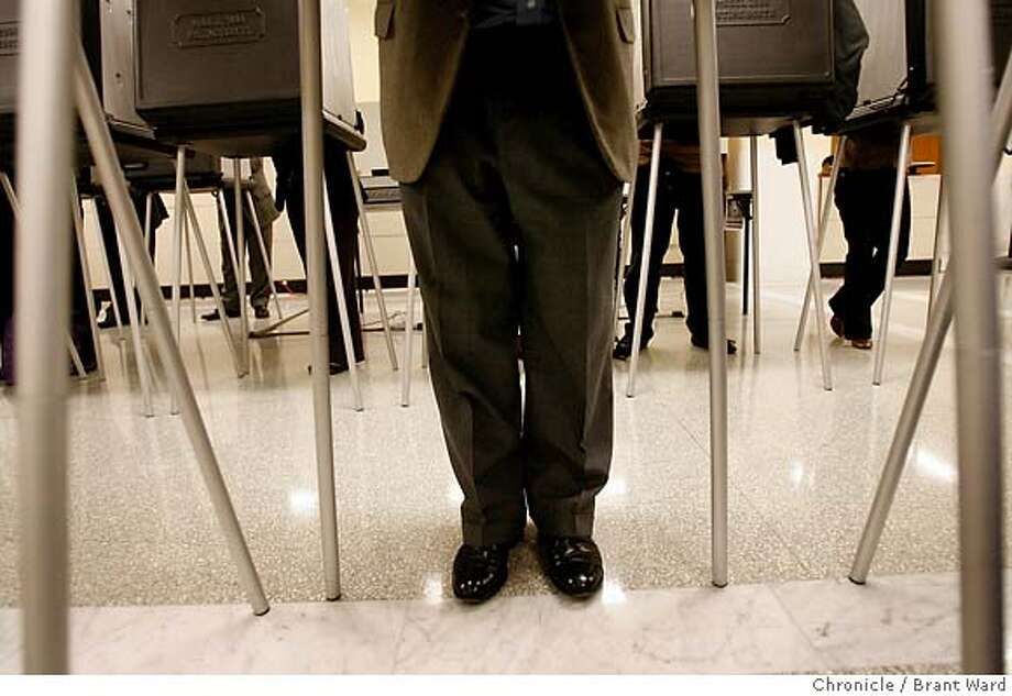 vote094.JPG  A couple dozen voting machines were arranged in the basement including a couple for disabled voters who could sit down. The machines were busy throughout the afternoon.  Scenes of absentee voters making their choices in the basement of City Hall Monday.  {Brant Ward/San Francisco Chronicle}11/6/06 Photo: Brant Ward