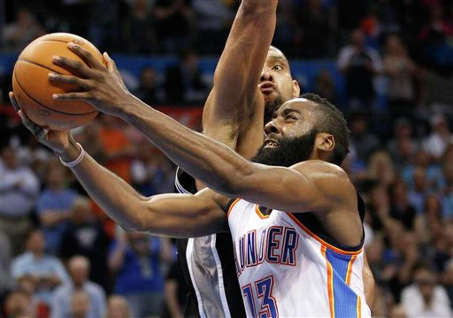 Oklahoma City Thunder guard James Harden (13) shoots in front of San Antonio Spurs forward Tim Duncan, rear, in the fourth quarter of an NBA basketball game in Oklahoma City, Friday, March 16, 2012. San Antonio won 114-105. (AP Photo/Sue Ogrocki) (AP)