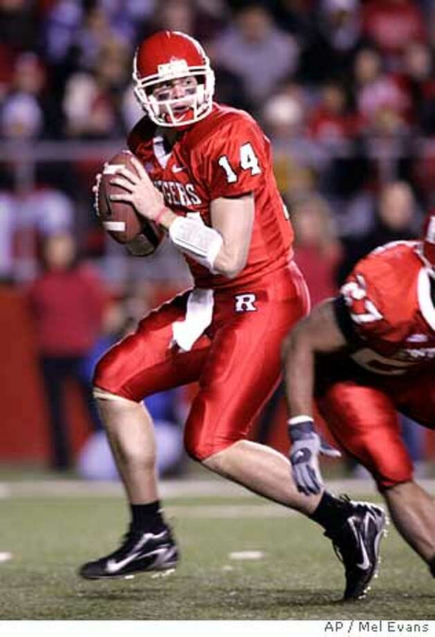 Rutgers quarterback Mike Teel rolls back to pass against Connecticut during second half NCAA football action Sunday, Oct. 29, 2006 in Piscataway, N.J. Rutgers won 24-13. (AP Photo/Mel Evans) Photo: MEL EVANS