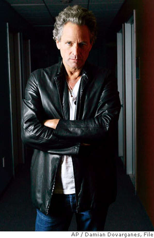 "Lindsey Buckingham poses for a photo at Victory Studios in Glendale, Calif., Thursday, Sept. 28, 2006. This fall finds Fleetwood Mac's on-again-off-again lead guitarist and producer, Buckingham, back on the road, touring behind his first new solo album in 14 years. Minimalist and almost entirely acoustic, ""Under the Skin,"" is a radical departure from nearly everything Buckingham has done. (AP Photo/Damian Dovarganes) Photo: DAMIAN DOVARGANES"