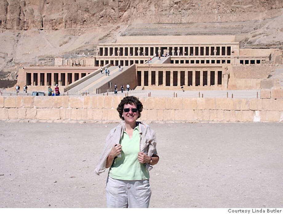 TRAVEL JUSTBACK -- Linda Butler standing in front of the Temple of Hatshepsut at Deir al-Bahri on the West Bank. to run: Nov. 5, 2006 Ran on: 11-05-2006 Ran on: 11-05-2006  Linda Butler standing in front of the Temple of Hatshepsut at Deir al-Bahri on Luxor's West Bank. Photo: HO