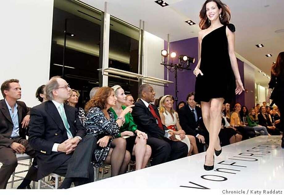 Diane von Furstenberg (pointing, from left), Vanessa Getty and Vogue's Andre Leon Talley watch von Furstenberg's show at Saks Fifth Avenue last week. Chronicle photo by Katy Raddatz