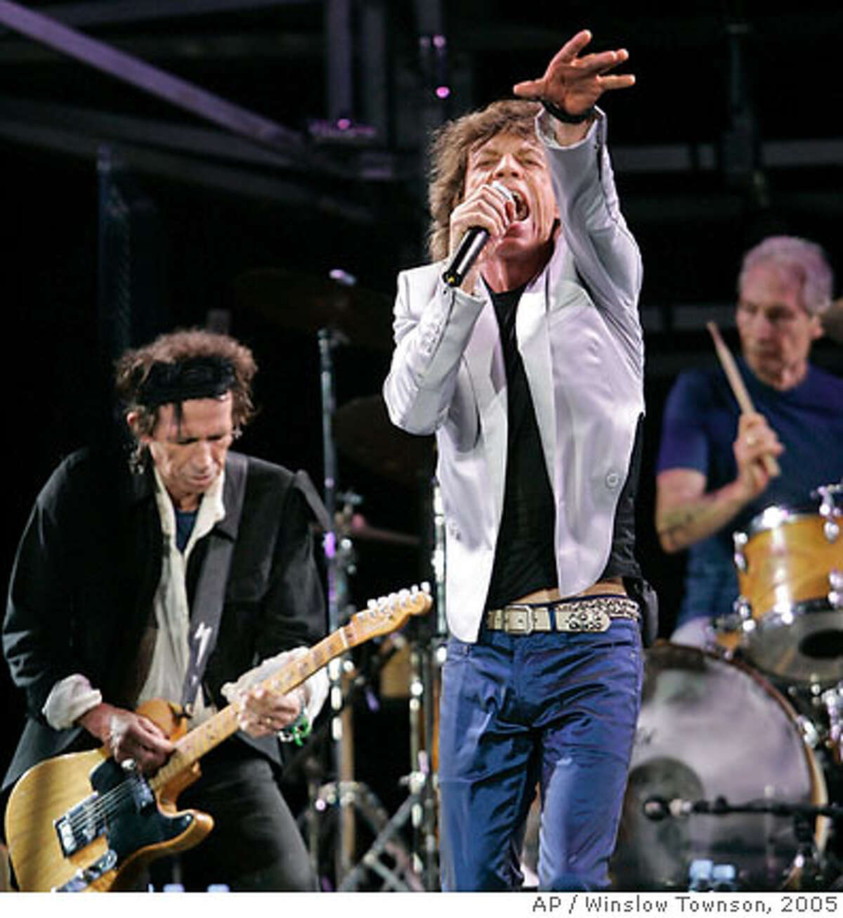 """Rolling Stones, from left, Keith Richards, Mick Jagger and Charlie Watts perform at Fenway Park in Boston Sunday, Aug. 21, 2005, where the group opened their """"A Bigger Bang"""" world tour. (AP Photo/Winslow Townson) Ran on: 08-22-2005 Ran on: 08-22-2005"""