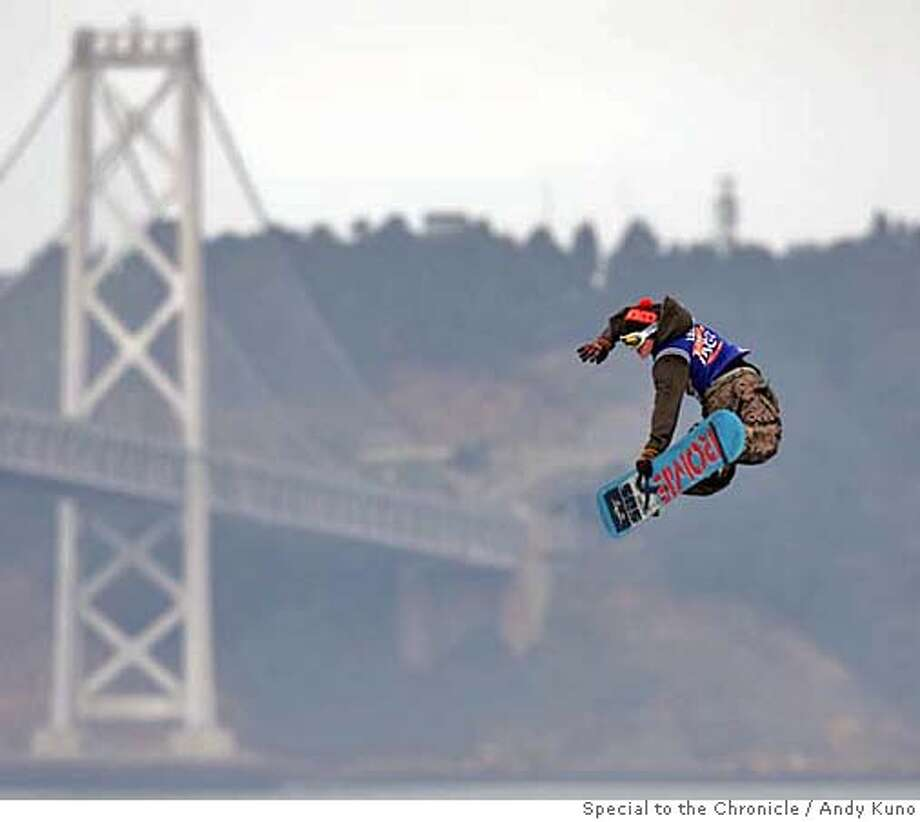 Snowboarder Bjorn Leines blasts a method air during a practice run at the ICER AIR event at AT&T Park in San Francisco, California Saturday November 4, 2006. By ANDY KUNO/SPECIAL TO THE CHRONICLE Photo: ANDY KUNO