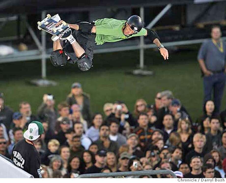 Skateboarding expert Tony Hawk performs on a ramp at an exhibition as he maneuvers above the crowd at Icer Air at AT&T Park in San Francisco, CA, on Saturday, November 04, 2006. 11/4/06 Darryl Bush / The Chronicle ** roster (cq) Photo: Darryl Bush