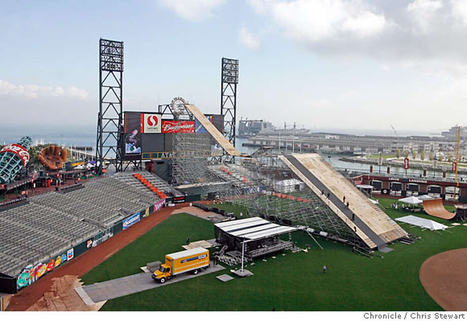 "icer air ski jump_0066_cs.jpg  Workmen put the finishing touches on a ski jump being erected at AT&T Park today, November 3, 2006. It will be covered with artificial snow this evening for the Saturday event. A press release provided the following information: ""Esurance ICER AIR is the first stadium big air ski and snowboard competition to be held in the United States. Continuing in the tradition of Icer Air 2005, Esurance ICER AIR is a unique and outrageous urban event that will break boundaries by bringing the snow from the slopes to San Francisco, merging urban and athletic communities with an exciting event. Twenty of the most accomplished world class skiers and snowboarders, including Olympic medalists and X-Games champions will descend a ramp more than 100 feet high, covered with over 200 tons of snow. Ideal jumps will have riders flying 80-100 feet at heights of up to 20 feet. Jonny Moseley will be on hand to host and emcee the event."" For further information, contact Casey Shaughnessy at 415-305-6082, cell.  Chris Stewart / The Chronicle Photo: Chris Stewart"