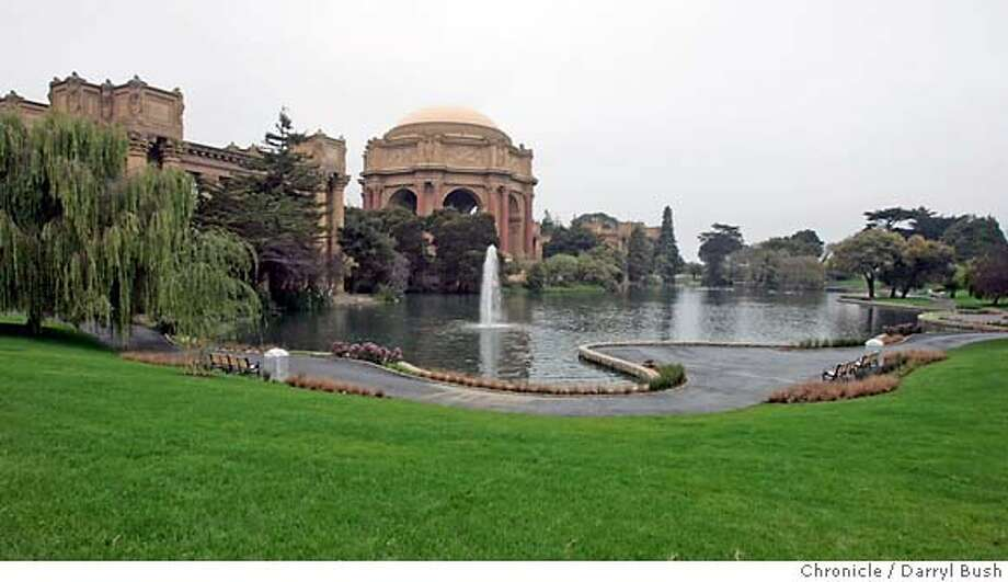 The newly restored Palace of Fine Arts lagoon with short benches, a lip that discourages plunges into the water and newly seeded lawn. Chronicle photo by Darryl Bush