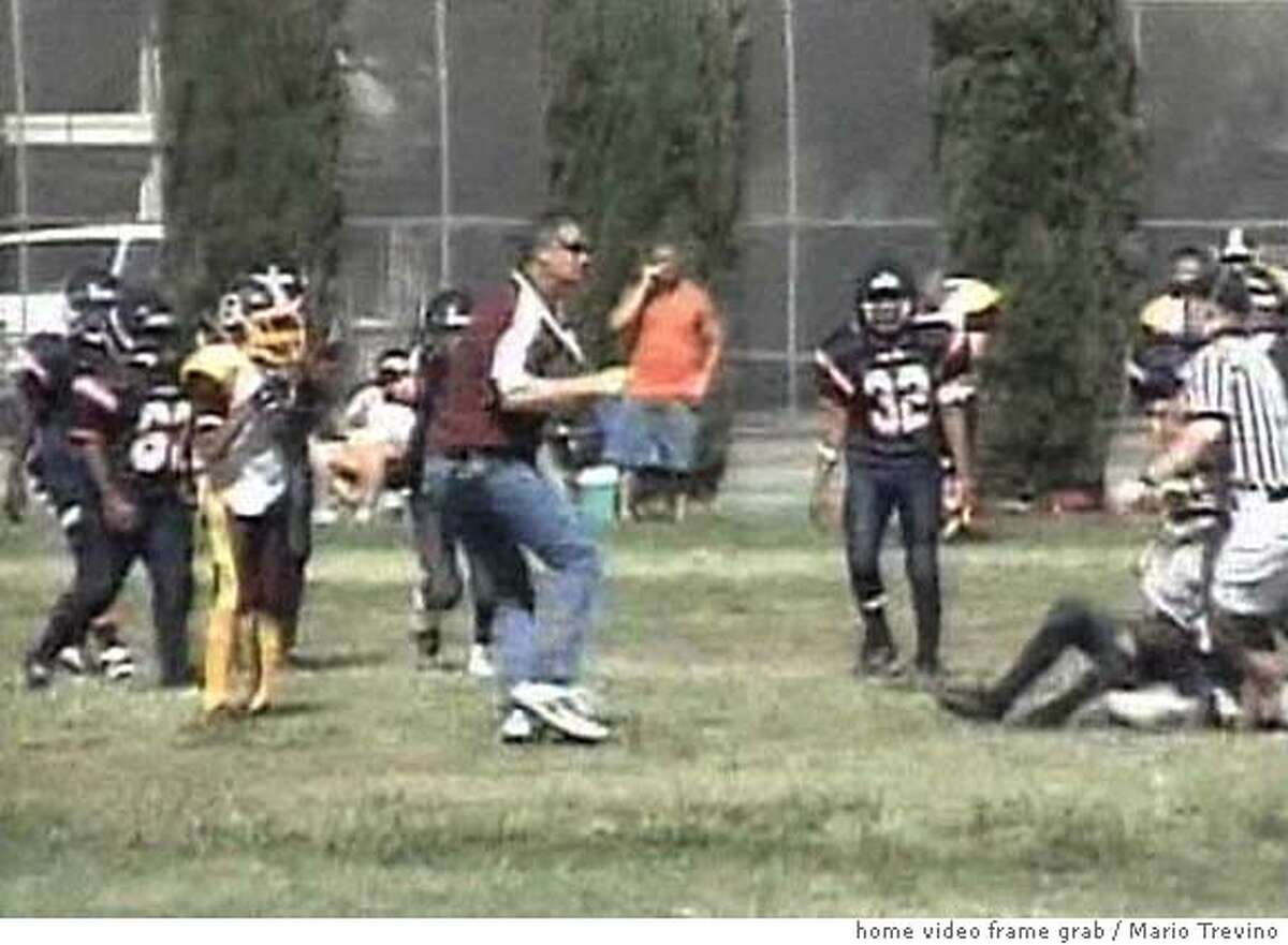 NEVIUS06 A Stockton youth football coach hits a boy on another team. Photo Courtesy Mario Trevino Permission to use 1 still photo. 209-271-4506 Ran on: 09-06-2006 Cory Petero can be seen on video, left, on the field where he rammed a player who had just hit Peteros son. Petero has been charged with felony child abuse. Ran on: 09-06-2006 Cory Petero can be seen on video, left, on the field where he rammed a youth football player. Petero has been charged with felony child abuse.