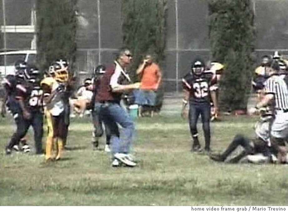 NEVIUS06  A Stockton youth football coach hits a boy on another team.  Photo Courtesy Mario Trevino  Permission to use 1 still photo.  209-271-4506  Ran on: 09-06-2006  Cory Petero can be seen on video, left, on the field where he rammed a player who had just hit Petero's son. Petero has been charged with felony child abuse.  Ran on: 09-06-2006  Cory Petero can be seen on video, left, on the field where he rammed a youth football player. Petero has been charged with felony child abuse. Photo: Mario Trevino