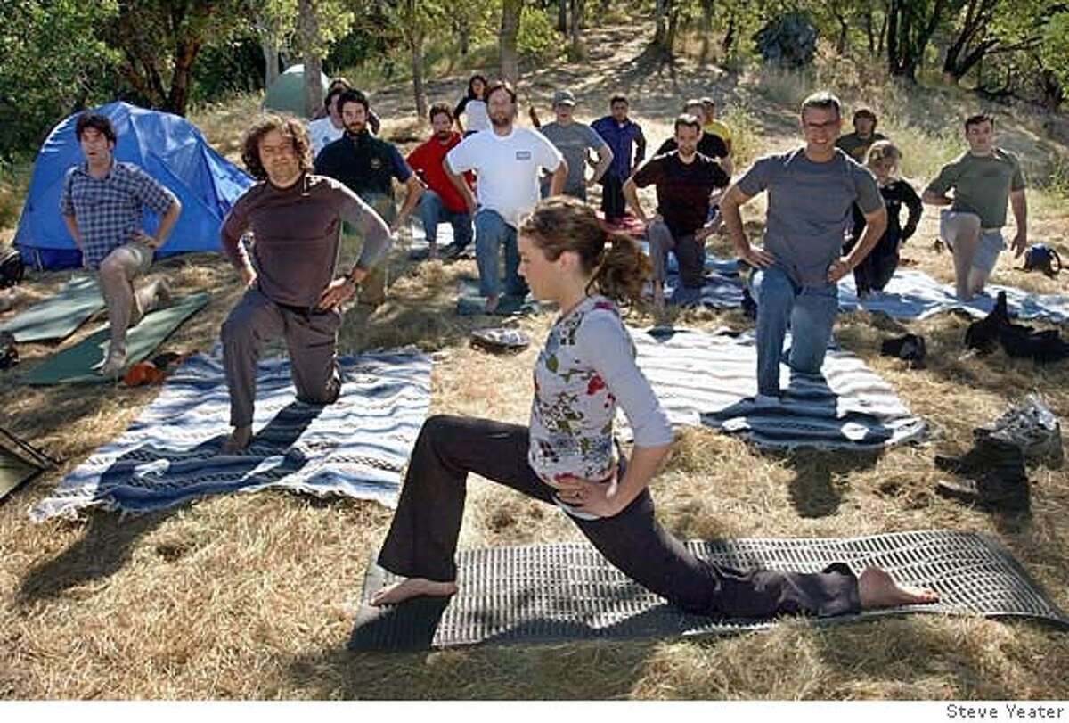 Yoga instructor Sarah Pullman from Vancover B.C. leads Wine Campers in a morning session at the campsite near Murphys, Calif., on Sunday, May 28, 2006.(Photo/Steve Yeater)