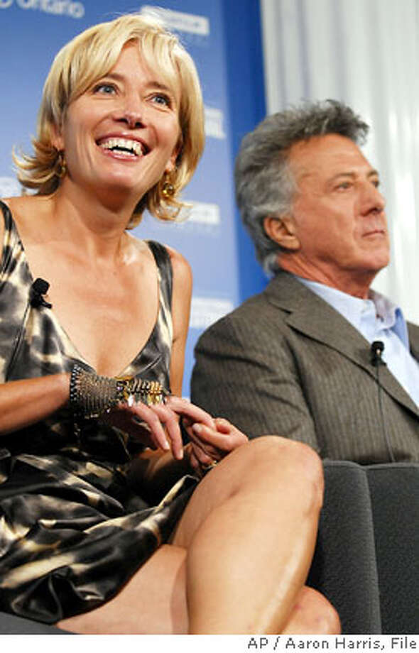 """Emma Thompson, left, smiles as Dustin Hoffman looks on during a news conference for the film, """"Stranger Than Fiction"""", during the Toronto International Film Festival in Toronto, Saturday, Sept. 9, 2006. Credit: Aaron Harris / Associated Press  Ran on: 11-05-2006  Emma Thompson and Dustin Hoffman promoted &quo;Stranger Than Fiction&quo; at the Toronto International Film Festival in September. Photo: Aaron Harris / Associated Press"""