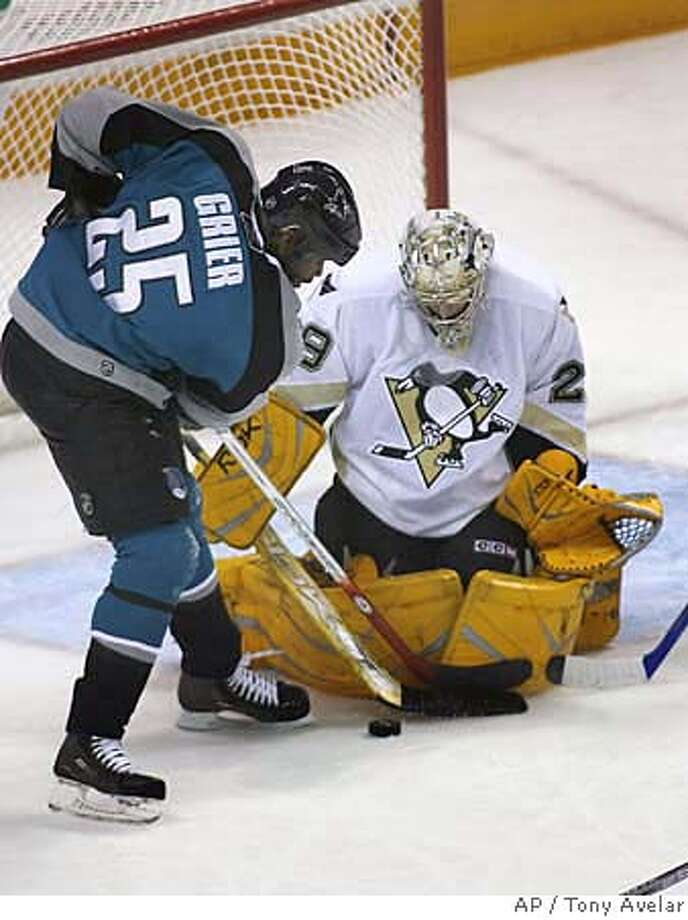 Pittsburgh Penguins goalie Marc-Andre Fleury blocks a shot by San Jose Sharks' Mike Grier during the second period of an NHL hockey game Saturday, Nov. 4, 2006, in San Jose, Calif. (AP Photo/Tony Avelar) Photo: TONY AVELAR
