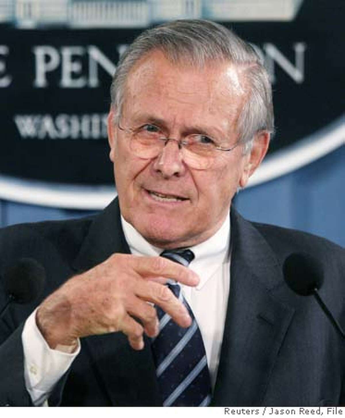 U.S. Secretary of Defense Donald Rumsfeld gestures while speaking at a news briefing at the Pentagon in Washington, in this October 26, 2006 file photo. U.S. President George Bush said on November 1, 2006 he expects Rumsfeld to stay on as defense secretary for the rest of the current administration, effectively rejecting election-year demands he resign over Iraq. REUTERS/Jason Reed/Files (UNITED STATES) 0