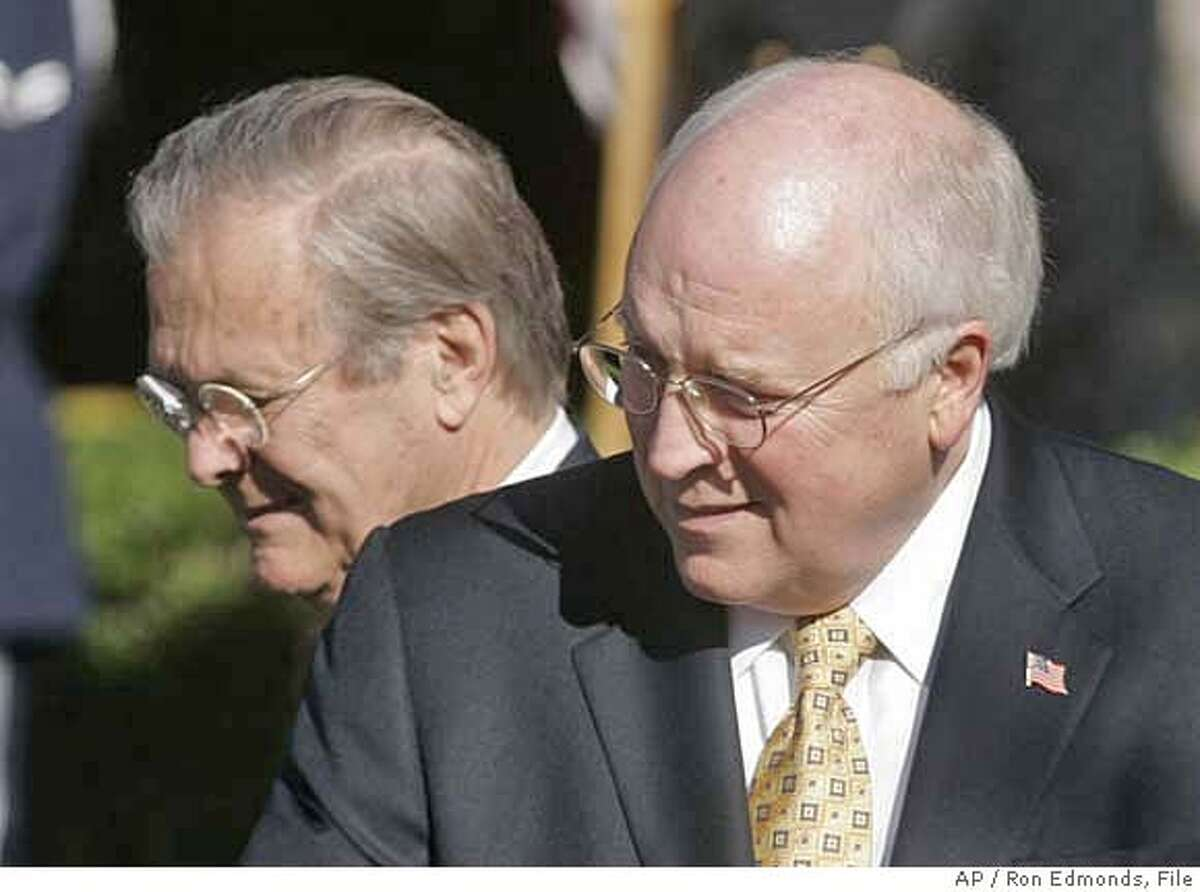 **FILE**Secretary of Defense Donald H. Rumsfeld, left, and Vice President Dick Cheney, right, take part in a arrival ceremony for Chinese President Hu Jintao, in this, Thursday, April 20, 2006, file photo at the White House. President Bush said Wednesday, Nov. 1, 2006, he wants Defense Secretary Donald Rumsfeld, left, and Vice President Dick Cheney, right, to remain in his administration until the end of his presidency (AP Photo/Ron Edmonds, file)