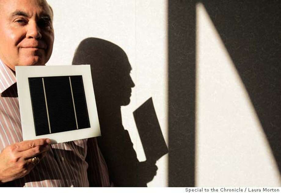 Dave Pearce, Chief Executive of Miasole, holds a solar cell in the company's offices in Santa Clara, CA. Miasole is trying to make solar cells that are much more efficient in generating electricity and could benefit from Prop. 87 if it passes. Photo: Laura Morton
