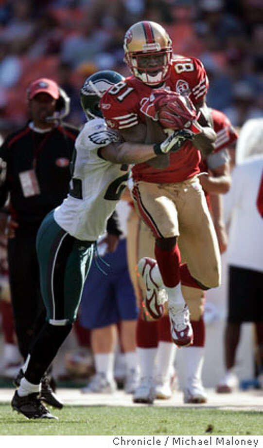 49ers Antonio Bryant (#81) grabs a 4th quarter pass from Alex Smith, Eagles Joselio Hanson covering.  San Francisco 49ers vs Phiadelphia Eagles at Monster Park.  Photo by Michael Maloney / San Francisco Chronicle on 9/24/06 in San Francisco,CA Ran on: 10-03-2006  Antonio Bryant needs to combine his gift of gab and gift of grab constructively.  Ran on: 10-03-2006  Antonio Bryant needs to combine his gift of gab and gift of grab constructively.  Ran on: 11-03-2006  Antonio Bryant accepts that he is often used as a decoy by an offense that's developing. Photo: Michael Maloney