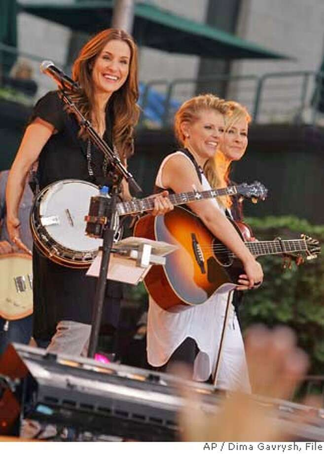 "Dixie Chicks, left to right, Emily Robison, Natalie Maines and Martie Maguire, perform on ABC's ""Good Morning America"" summer concert series in Bryant Park, Friday, May 26, 2006 in New York.They are promoting their new album, ""Taking the Long Way,"" out this week. (AP Photo/Dima Gavrysh)  Ran on: 06-02-2006  The Dixie Chicks (from left): Emily Robison, Natalie Maines and Martie Maguire. Photo: DIMA GAVRYSH"