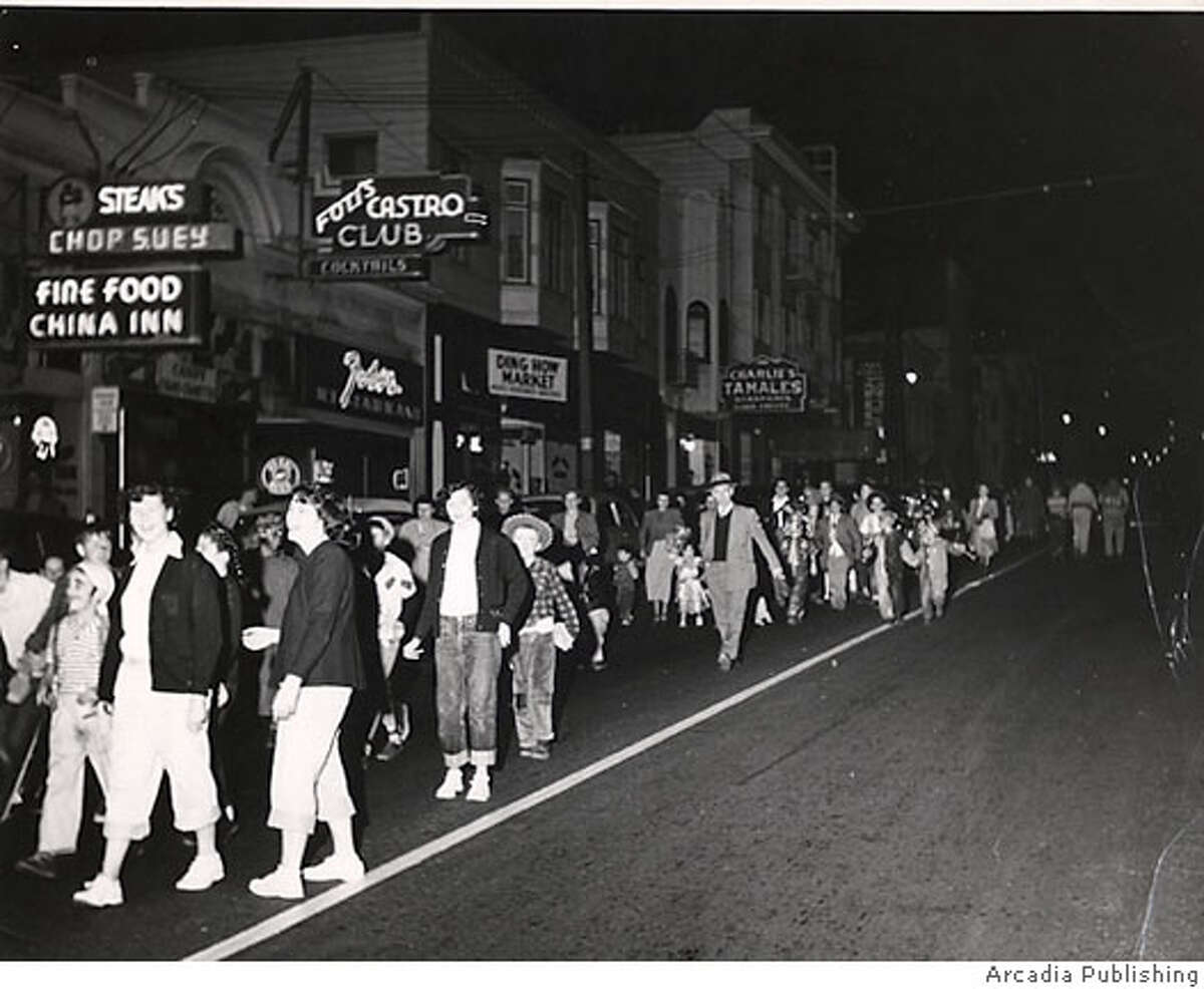 """WBSTRANGE3.JPG / for: Friday slug: WBSTRANGE; Ernie DeBaca takes care of closing off the street for a children's Halloween parade every year starting in 1946. The children's parade is still a feature of the neighborhood, though these days it's sponsored by the Sisters of Perpetual Indulgence. Cliff's Variety / HO Photos are from """"Images of American: San Francisco's Castro"""" ProductNameChronicle Ran on: 11-03-2006 The owners of Cliffs Variety in the Castro started the Halloween celebrations in 1948 as a costume contest for local children."""