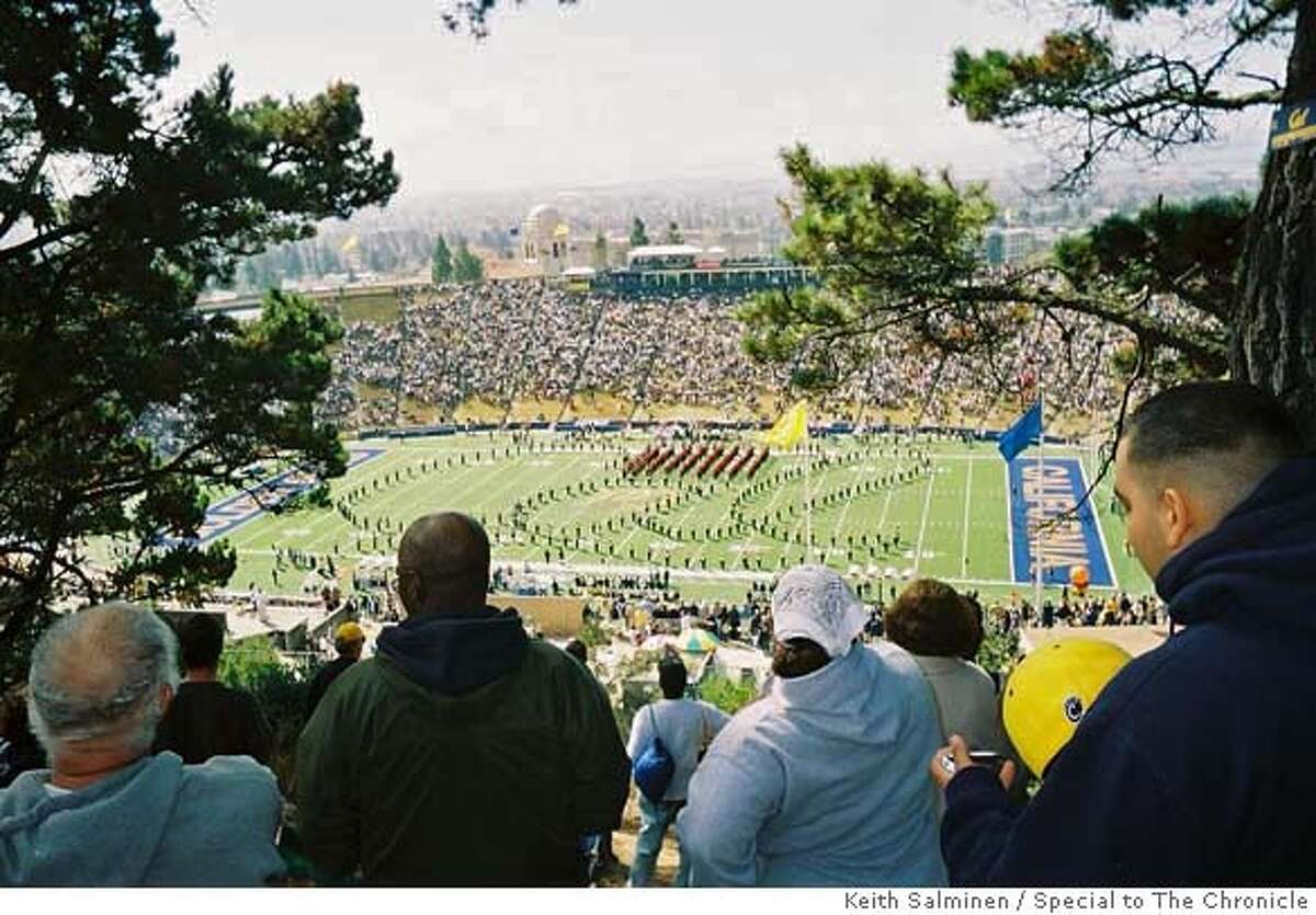 Berkeley, CA--Fans watch the Cal Marching Band on the Field at Memorial Stadium from Tightwad Hill before a recent game. Keith Salminen/Special to The Chronicle