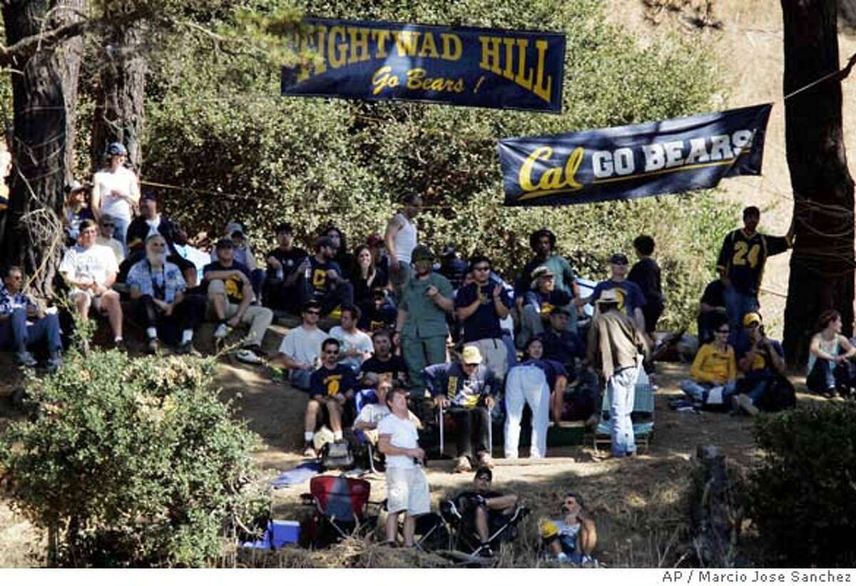 Fans watch a college football game between California and Washington from a hilltop overlooking Memorial Stadium in Berkeley, Calif. on Saturday, Oct. 21, 2006. The hill, known as Tightwad Hill, offers breathtaking views of the Bay area. Yet most people who make the short trek up this side of Strawberry Canyon on autumn Saturdays aren't here for the spectacular scenery. For more than 80 years, they've just been looking for the cheapest seats in Berkeley. (AP Photo/Marcio Jose Sanchez)