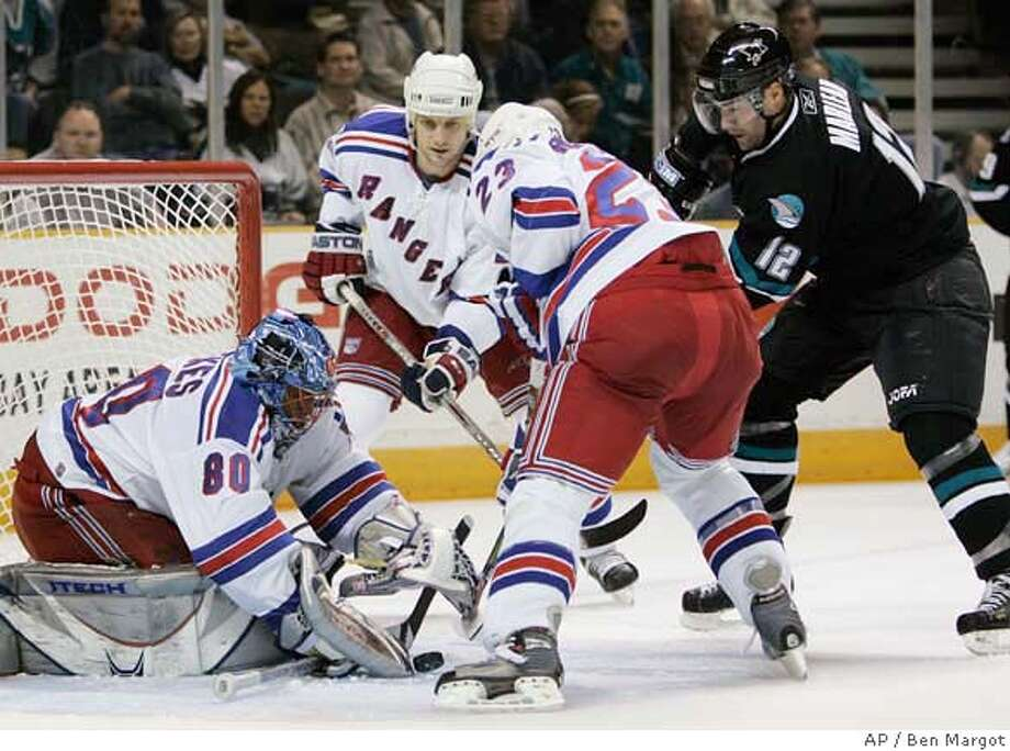 From left, New York Rangers goalie Kevin Weekes (80), Sandis Ozolinsh, and Karel Rachunek (23) block a shot by San Jose Sharks' Patrick Marleau in the second period of a hockey game Thursday, Nov. 2, 2006, in San Jose, Calif. (AP Photo/Ben Margot) Photo: BEN MARGOT