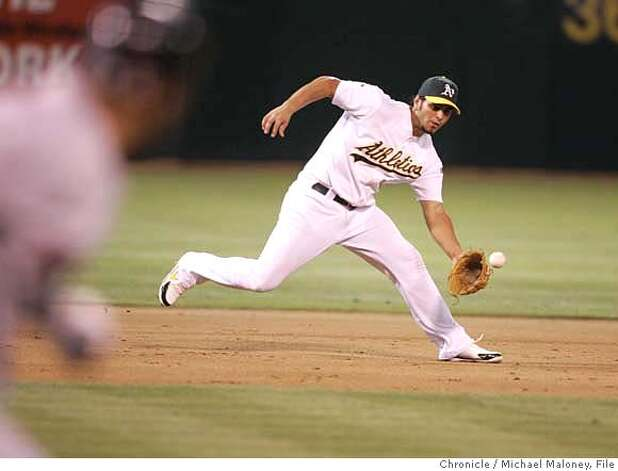 Athletics Eric Chavez grabs a grounder by Boston's Alex Gonzalez. Oakland Athletics vs Boston Red Sox at McAfee Coliseum in Oakland.  Photo by Michael Maloney / San Francisco Chronicle on 7/24/06 in Oakland,CA  Ran on: 07-25-2006  Manny Ramirez went deep, but the A's-Red Sox game was not finished by press time. See sfgate.com for the game story.  Ran on: 07-25-2006  Manny Ramirez hit a three-run home run, helping the Red Sox beat the A's. Story is on Page C5.  Ran on: 07-25-2006  Manny Ramirez relishes his three-run homer in the third inning. Boston also got homers from Alex Gonzalez and David Ortiz. MANDATORY CREDIT FOR PHOTOG AND SF CHRONICLE/ -MAGS OUT Photo: Michael Maloney