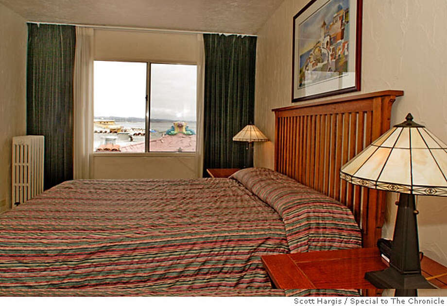 BEDROOM IN OCEAN VIEW SUITE AT CAPITOLA VENETIAN HOTEL, CAPITOLA CA Photo: Scott Hargis