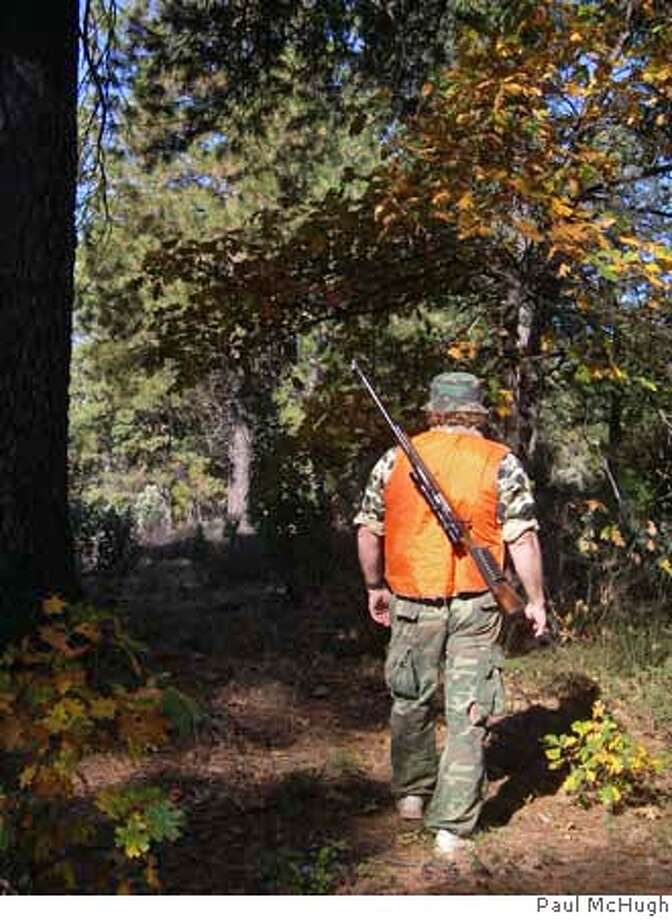 A hunter steps into the autumn woods in El Dorado National Forest. CREDIT: Paul McHugh Photo: Paul McHugh