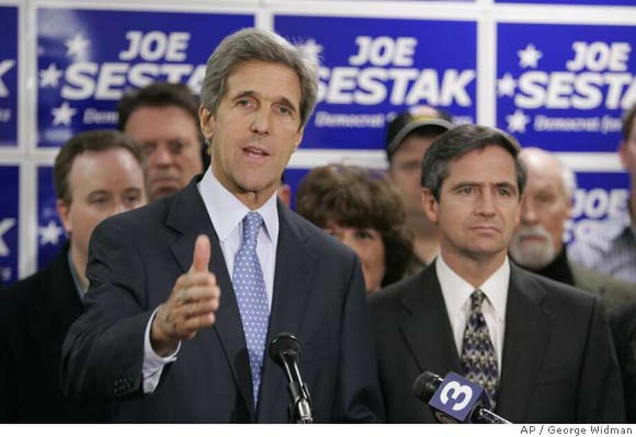 Democratic congressional challenger Joe Sestak, right, listens in as Sen. John Kerry, D-Mass., speaks during a campaign stop in Radnor, Pa., Thursday, Oct. 26, 2006. (AP Photo/George Widman) STAND ALONE PHOTO Photo: GEORGE WIDMAN