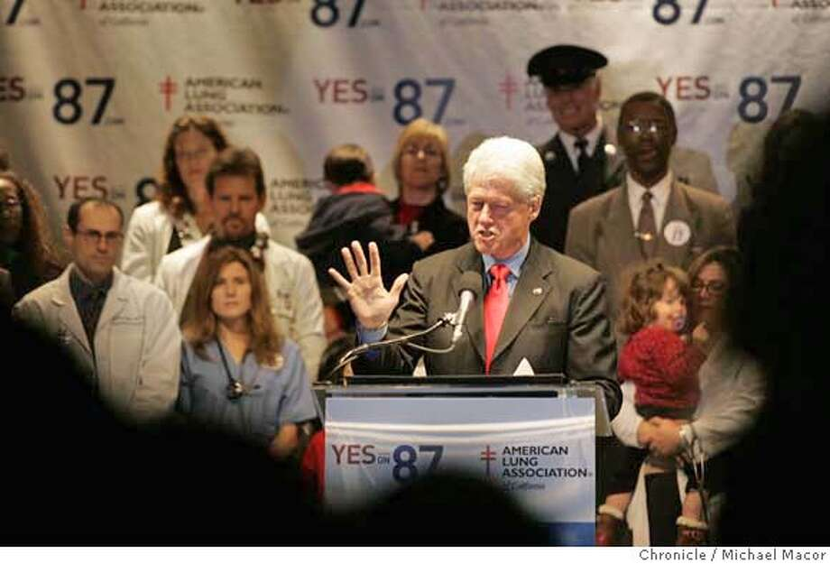 climton_075_mac.jpg Clinton makes points in favor of Prop. 87 during his address at the rally. Former President Bill Clinton leads a rally in downtown San Francisco to support Prop. 87, an initiative that seeks to tax oil production to fund development of alternative fuels. Event in, San Francisco, Ca, on 11/1/06. Photo by: Michael Macor/ San Francisco Chronicle Mandatory credit for Photographer and San Francisco Chronicle / Magazines Out Photo: Michael Macor