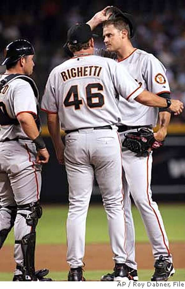 San Francisco Giants pitching coach Dave Righetti (46) talks with starter Jamey Wright, right, as catcher Eliezer Alfonzo, left, looks on, after Wright gave up three runs during the first inning of their baseball game against the Arizona Diamondbacks, Tuesday, Aug. 8, 2006, in Phoenix.(AP Photo/Roy Dabner)  Ran on: 08-09-2006 Ran on: 08-09-2006 Ran on: 08-09-2006 Photo: ROY DABNER