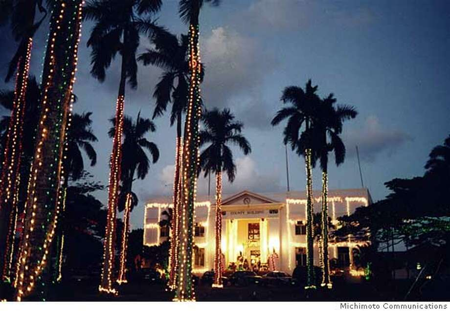 Kauai's historic county building in Lihue is lit for  Christmas in the annual Festival of Lights. Photo courtesy of Michimoto Communications.