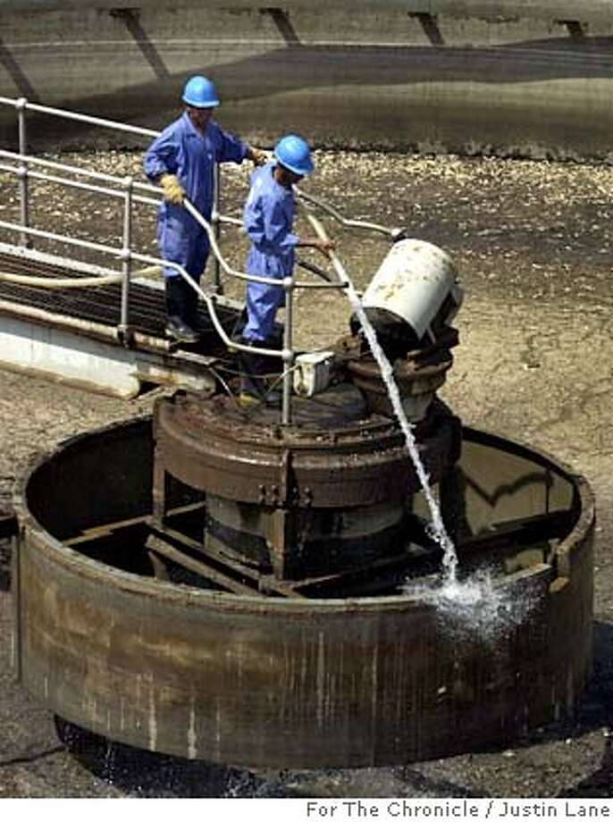 BECHTEL2.jpg 09/04/03--Bagdad, Iraq-- for David Baker Story  Two workers at a sewage treatment plant in Baghdad, Iraq work to clean up some of the machinery so the plant can be come operational again. The project, among many others in post war Iraq, is being overseen by Bechtel International Systems.  JUSTIN LANE FOR THE SAN FRANSISCO CHRONICLE ; on 9/4/03 in Baghdad. Justin Lane / Special To The Chronicle Ran on: 07-04-2004  Workers in Baghdad, left, clean equipment at a sewage plant in Baghdad, above, in a project overseen by Bechtel. As of June 22, only $366 million of the $18.4 billion U.S. package had been spent, the White House budget office says. Nothing from the package has been spent on sanitation or water. MANDATORY CREDIT FOR PHOTOG AND SF CHRONICLE/ -MAGS OUT Photo: Justin Lane