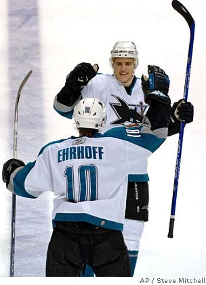 San Jose Sharks center Patrick Marleau (12) congratulates teammate Christian Ehrhoff (10) of Germany after Ehrhoff scored a power-play goal with 35.8 seconds left to give the Sharks a 2-1 victory over the Florida PanthersTuesday, Oct. 31, 2006, in Sunrise, Fla. (AP Photo/Steve Mitchell) Photo: STEVE MITCHELL