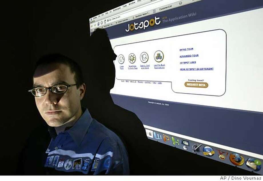 Joe Kraus, CEO of JotSpot.com, a wiki software provider, poses with his company's website in his Palo Alto, Calif., offices, Tuesday, Feb. 8, 2005. JotSpot, a Palo Alto-based startup, is betting on a future explosion of so-called Wikis, a type of Web page that can be edited by anyone, and making them a staging area of sorts for information. (AP Photo/Dino Vournas) Photo: DINO VOURNAS