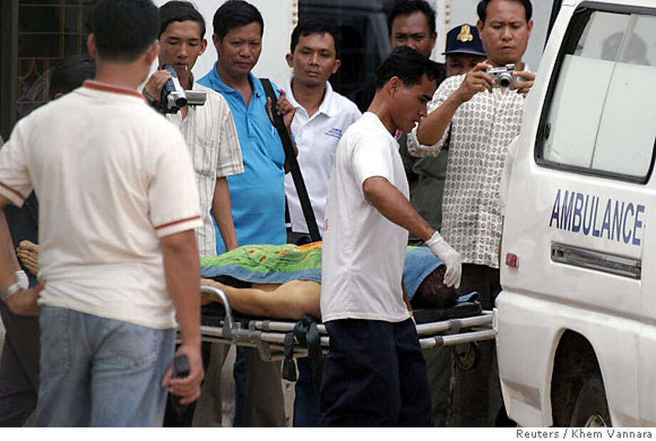 Donald Ramirez's body is brought into an ambulance heading to a hospital inside the anti-human trafficking police facilities in Phnom Penh October 31, 2006. Ramirez, a San Francisco policeman charged last week with sexually assaulting a 14-year-old girl in Cambodia, committed suicide in his jail cell on Tuesday, police said. REUTERS/Khem Vannara (CAMBODIA) Photo: STRINGER/CAMBODIA