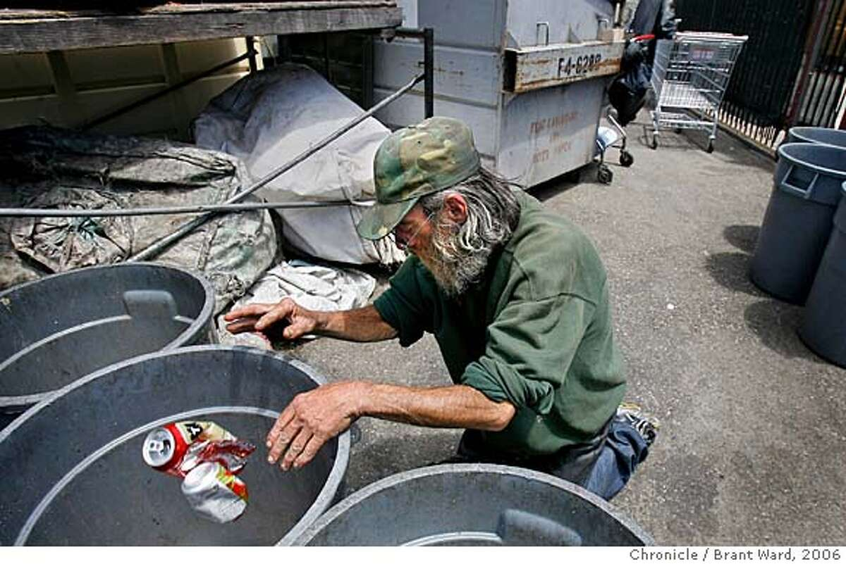 landscape003.jpg Michael sorts his cans at the recycling area on Market Street. Aluminum is the biggest money maker for a recycler like Michael. Michael Dick is typical of the longtime chronic homeless in San Francisco. He has been living on the streets for over a decade, manages to make a little money recycling, and has medical problems that are forcing him to rethink his lifestyle. He decides to get General Assistance and get permanent housing after growing tired of wandering the streets. {Brant Ward/The Chronicle} 7/12/06