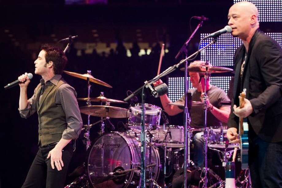 Train's Monahan, left, Scott Underwood on drums and Stafford on guitar on March 16. (Smiley N. Pool / Houston Chronicle)