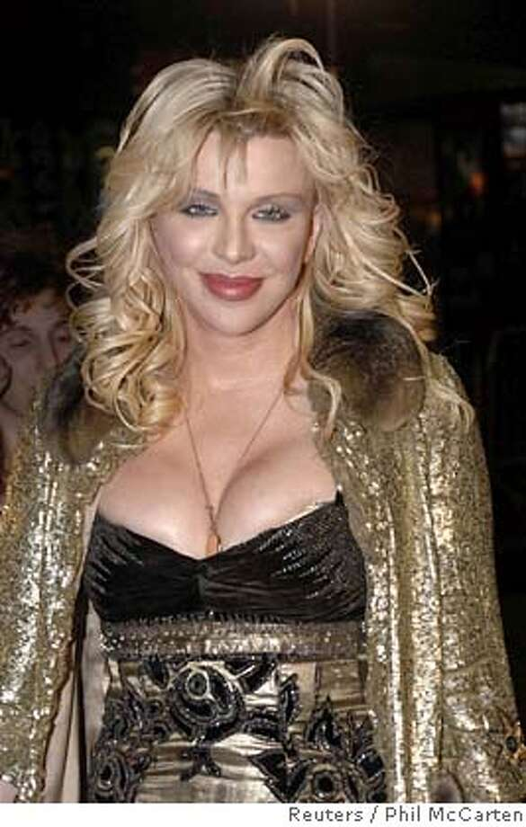 "Actress Courtney Love arrives for the U.S. premiere of ""Borat: Cultural Learnings of America for Make Benefit the Glorious Nation of Kazakhstan"" at the Grauman's Chinese Theatre in Hollywood October 23, 2006. REUTERS/Phil McCarten (UNITED STATES) 0 Photo: PHIL McCARTEN"