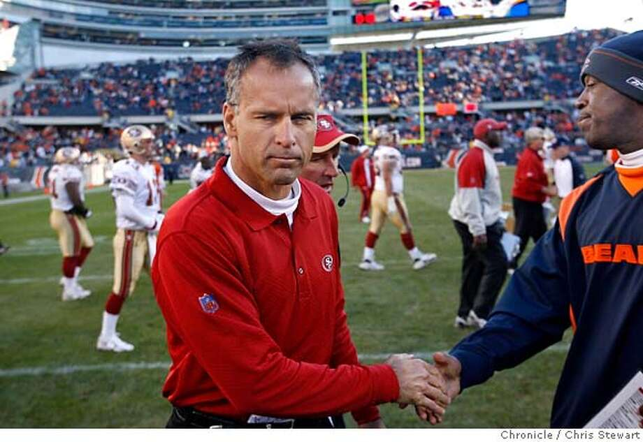 The San Francisco 49ers head coach Mike Nolan grimly shakes hands with Chicago Bears head coach Lovie Smith after losing to the Bears 41-10 in an error-filled game today, October 29, 2006 at Soldier Field in Chicago. Chris Stewart / The Chronicle San Francisco 49ers, Chicago Bears Photo: Chris Stewart