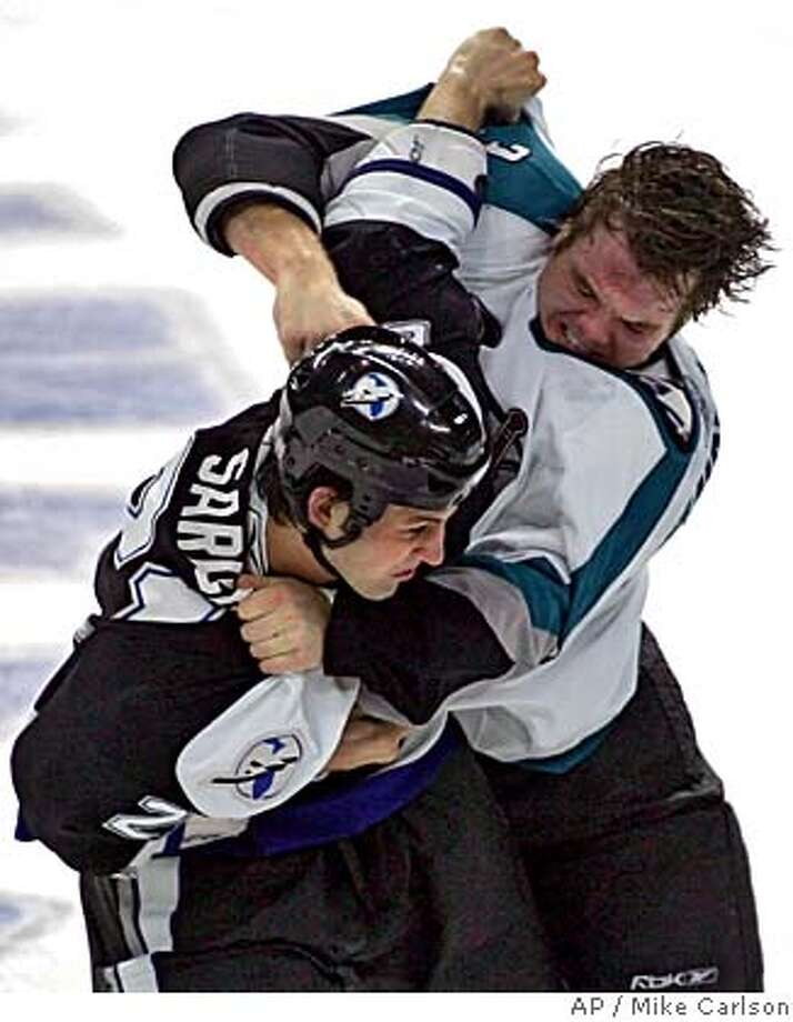 San Jose Sharks' Doug Murray, right, lands a punch to the helmet of Tampa Bay Lightning's Cory Sarich during the second period an NHL hockey game Sunday, Oct. 29, 2006, in Tampa, Fla. (AP Photo/Mike Carlson) Photo: MIKE CARLSON