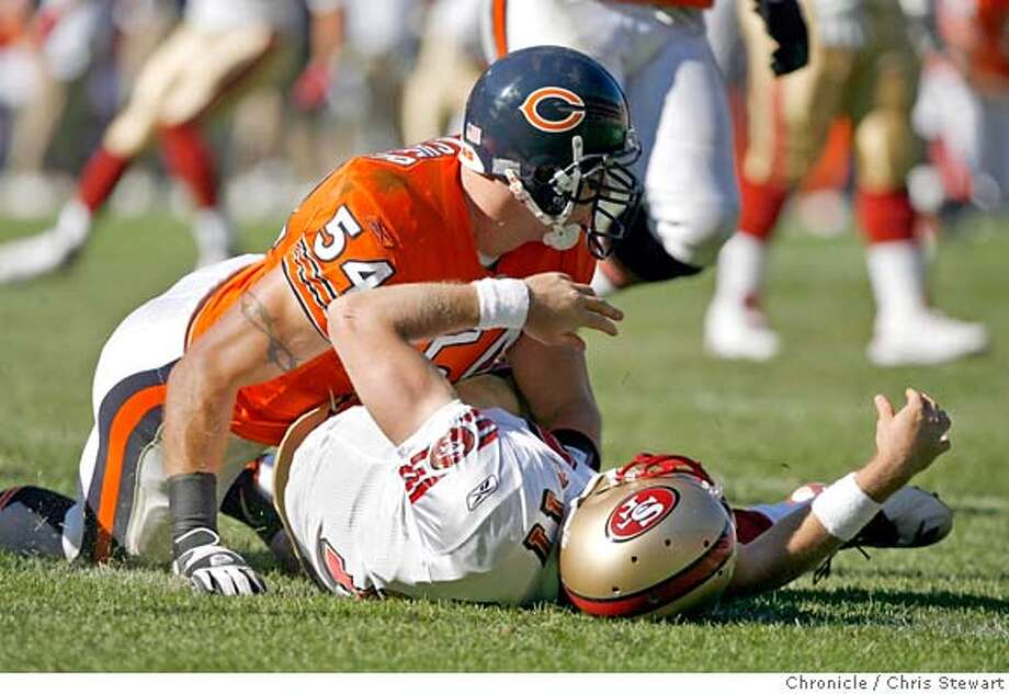 49ers_293_cs.jpg San Francisco 49ers QB Alex Smith (11) is brought down by the Chicago Bears Brian Urlacher (54), forcing an incomplete pass in the second quarter. The 49ers lost to the Bears 41-10 in an error-ridden game today, October 29, 2006 at Soldier Field in Chicago. Chris Stewart / The Chronicle San Francisco 49ers, Chicago Bears MANDATORY CREDIT FOR PHOTOG AND SF CHRONICLE/ -MAGS OUT Photo: Chris Stewart