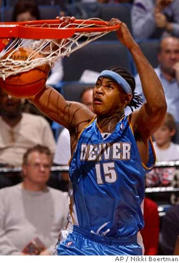 Denver Nuggets Carmelo Anthony dunks uncontested during the third quarter against the Memphis Grizzlies Sunday, Jan. 25, 2004 in Memphis, Tenn. Anthony led the scoring for the Nuggets with 25 points but the Grizzlies won, 106-88. (AP Photo/ Nikki Boertman) Cleveland's LeBron James has made the jump from high school to the NBA, but not to the All-Star Game as a rookie. Cleveland's LeBron James has made the jump from high school to the NBA, but not to the All-Star Game as a rookie. Ran on: 02-13-2005  Anthony brought Denver back to respectability in his rookie year, leading a playoff push. Photo: NIKKI BOERTMAN