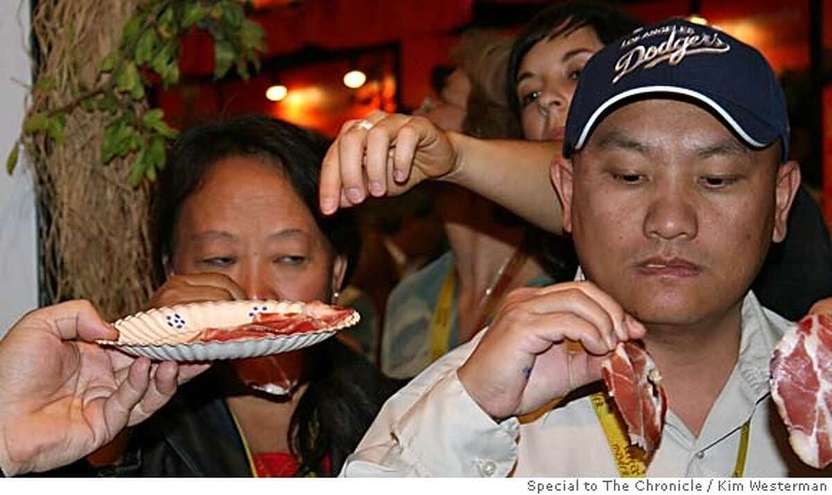 SLOWFOOD30_ph1.jpg May Yang Vang and Blong Lee, taste cured meat (capocollo) in Turin, Italy. May is a farmer from Fresno. Kim Westerman / Special to The Chronicle