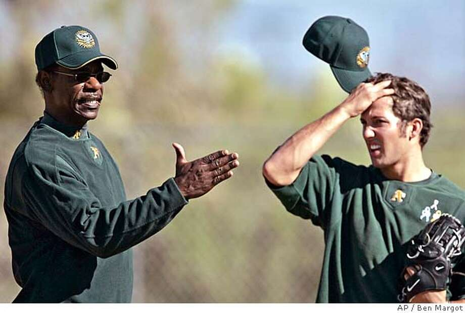 Oakland Athletics third base coach Ron Washington, left, instructs players including pitcher Houston Street, right, during a Major League baseball spring training workout Sunday, Feb. 19, 2006, in Phoenix. (AP Photo/Ben Margot)Ran on: 02-22-2006  Ron Washington (left), A's third base coach, gives pointers to pitcher Huston Street at spring training. EFE OUT Photo: BEN MARGOT